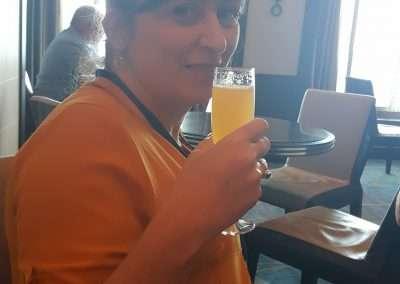Kim drinking a Mimosa - Norwegian Escape Cruise