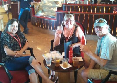 Kim, Colleen and Mike having drinks on the ship