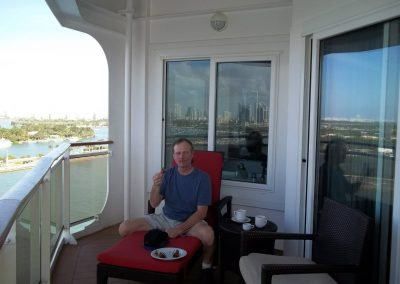 Mike on the balcony of the Norwegian Epic Cruise Ship
