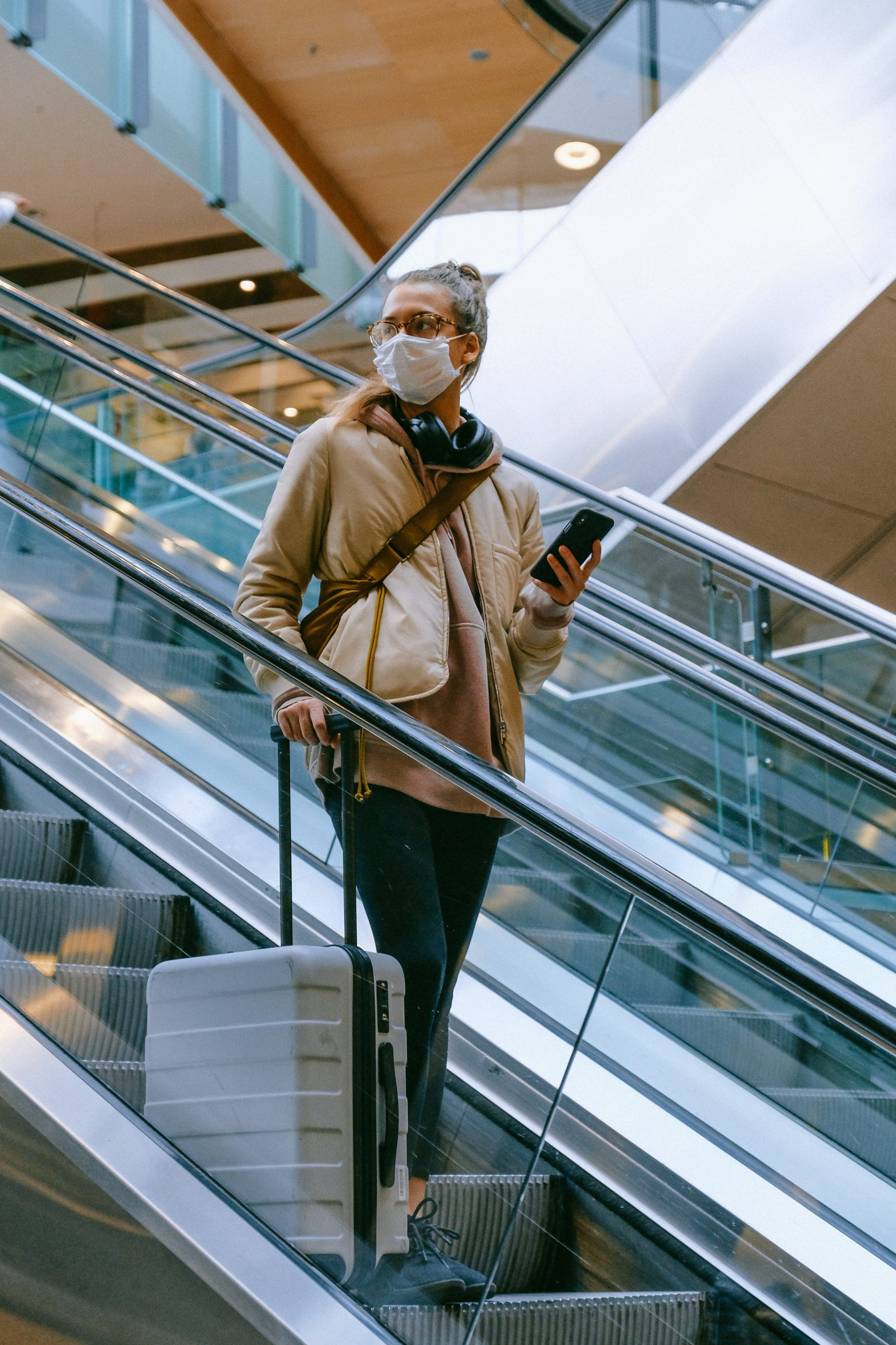Woman at airport - How To Travel Safely During The Pandemic